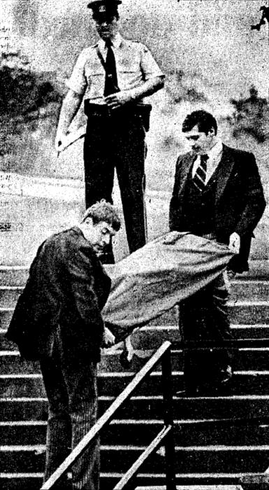 Coroner moving Shirley Hauser's body
