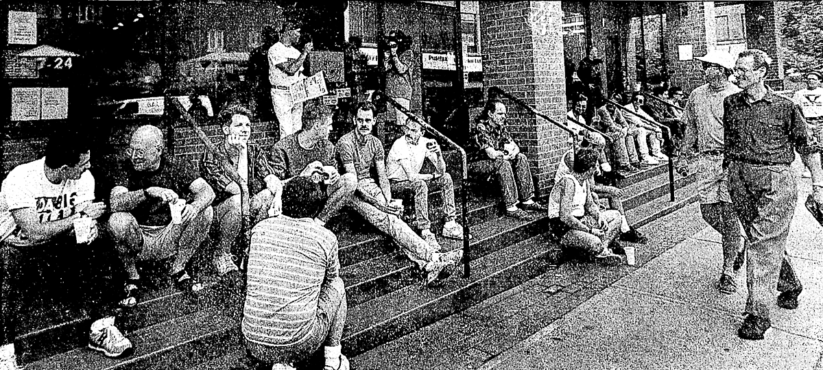 "Figure 10. ""People tend to sit where there are places to sit"" — William H. Whyte on the social life of small urban spaces. A daytime view of The Steps during the early 1990s [Andrew Stawicki, Toronto Star]."