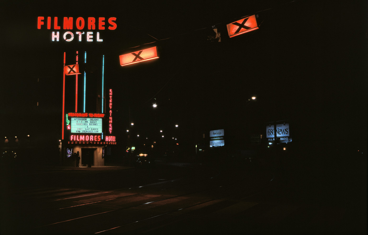 The craft neon wayfinding legibility of Filmores Hotel: a varicoloured beacon hailing from the sunset of Toronto's manufacturing age, 17 May 2008. [Idlewild]