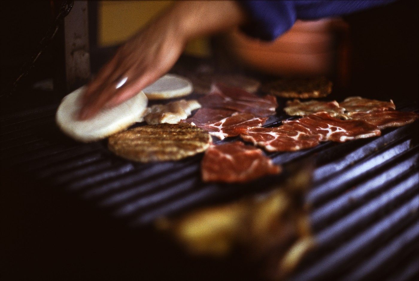 Real street meat can't be beat: bondiola & burgers sizzling at an outdoor parrilla kiosk in Buenos Aires (Astrid Idlewild)