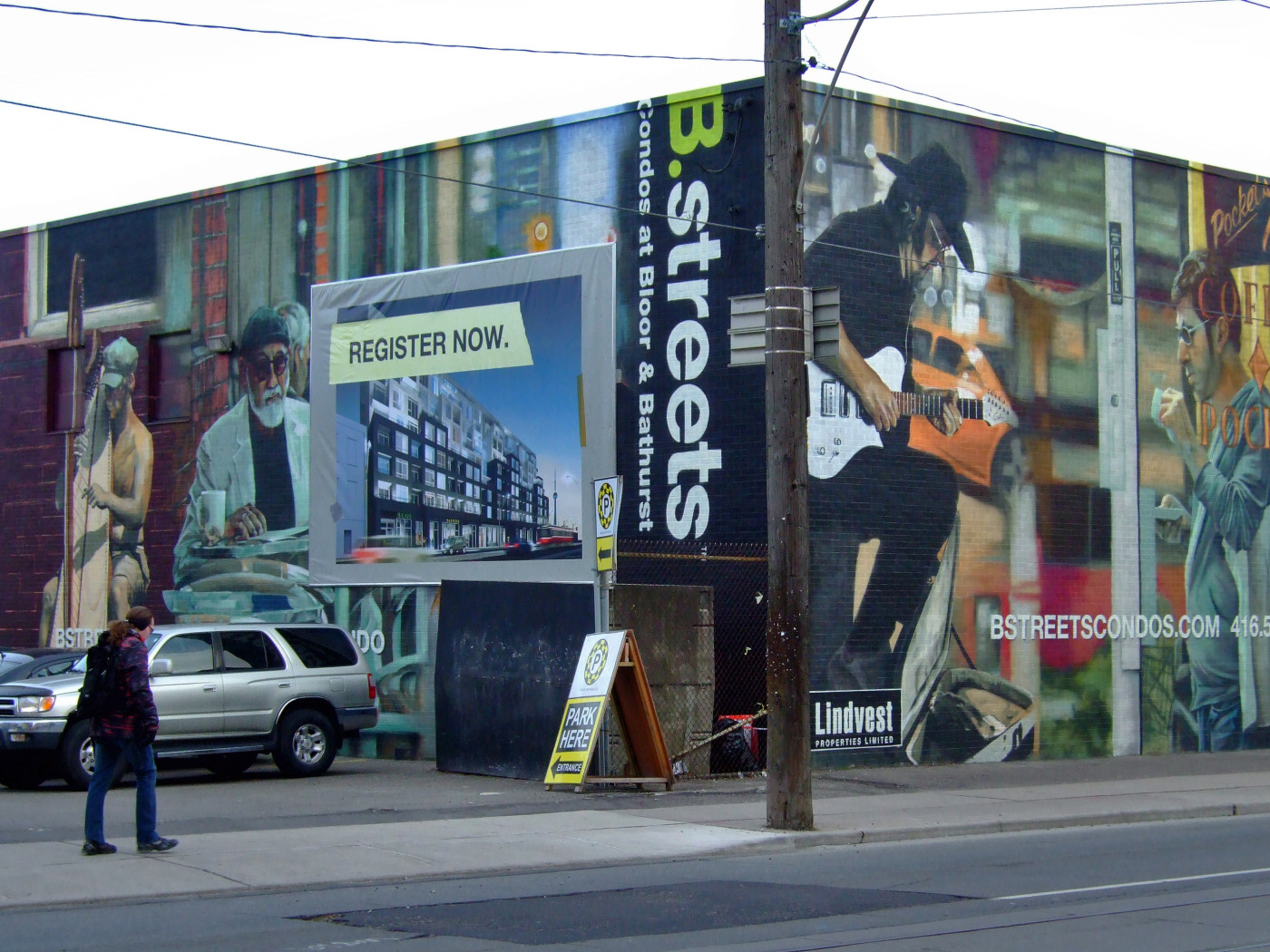 """Figure 4. """"B.streets"""" proposed site, 2011, will occupy the former Loretto College building at Central Tech School at Bathurst, near Bloor. The project launched with unusual fanfare, including a prominent piece in the Toronto Star in September 2011. While conceptual mural art depicts a lively street life reminiscent more of New Orleans or Portland than of Toronto, the inset illustration of the edifice shows no trace that the """"B.streets"""" name will survive once construction is completed. [Idlewild]"""