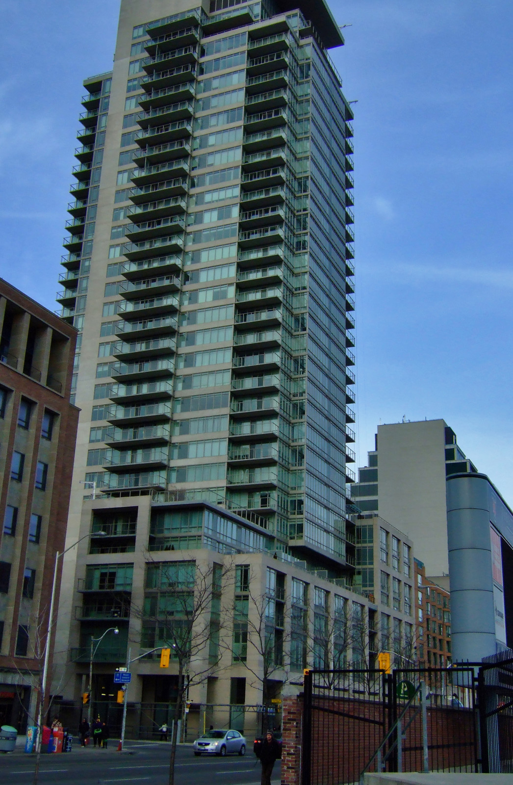 """Figure 6. One Bedford at Bloor, completed in 2011, was the subject of considerable controversy by residents and existing businesses before pre-construction demolition began in late 2006. Residents' concerns of excessive height (relative to existing built form) and lost business were allayed, allowing the project to proceed. No inscription of the """"One Bedford at Bloor"""" toponym remains. [Idlewild]"""
