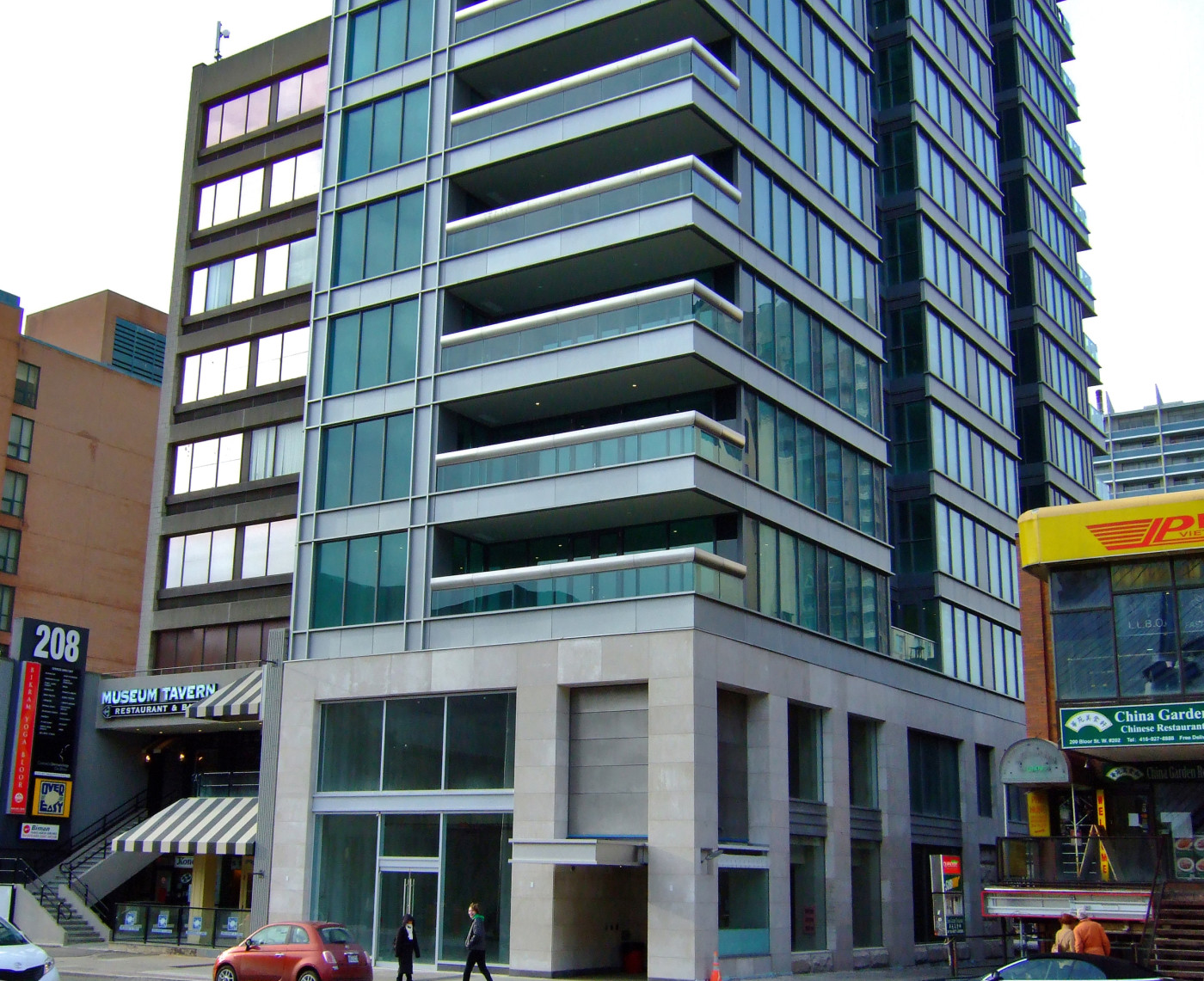 """Figure 2. Site of the completed Museumhouse condo tower, 2012. No inscription of the ephemeral toponym """"Museumhouse"""" and no commercial inscription for the suite space. Small overhang at right is the discreet pedestrian entrance to the secured building. [Idlewild]"""