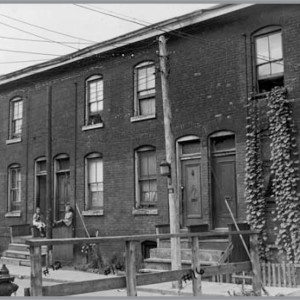 Figure 12. 2–16 Midland Pl. (west side), formerly Wallace Ave. Lane created by william wallace; 2–16 built by John Watson in 1891 (City of Toronto Archives, 18 August 1949).