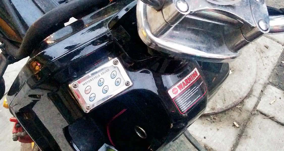 """""""Motorcycle Sounds"""" sound-effects pad on a garden-variety """"e-bike"""" [Idlewild]"""